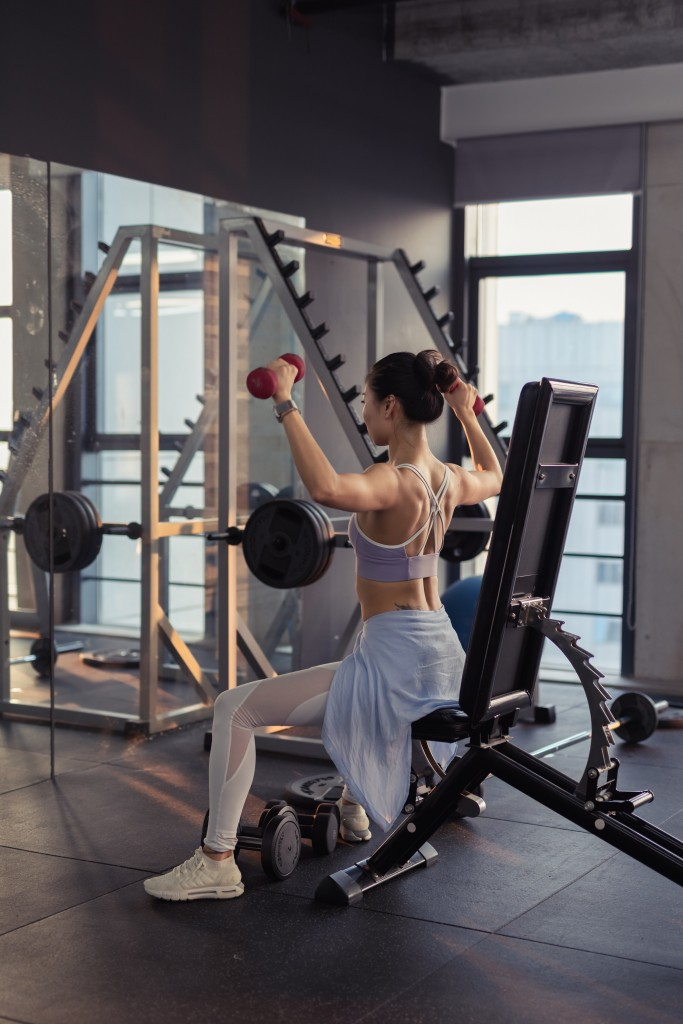 Photo Of Woman Raising Dumbbells 2475878