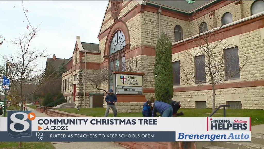 Members Of The Christ Episcopal Church Are Moving Their Community Christmas Tree Outdoors