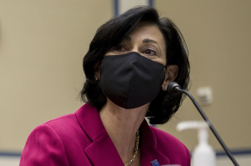 The Latest: Cdc: Vaccinated Can Go Outside Without Mask