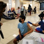 The Latest: Oregon Sets Vaccination Targets For Reopening