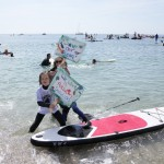 The Latest: Climate Change Protests Hit Beach Near G7 Summit