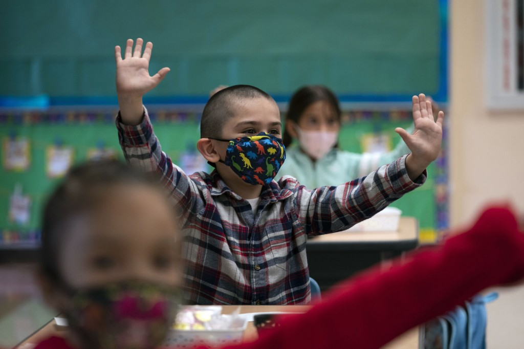 The Latest: California To Require Masks At Schools In Fall