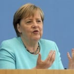 The Latest: Germany Warns Unvaccinated May Face Restrictions