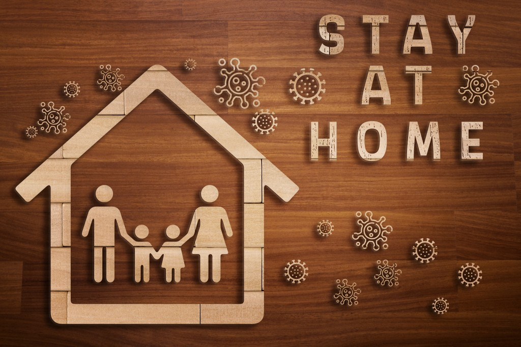 Wooden Silhouette Of Family In A House Concept Of Coronavirus Pandemic