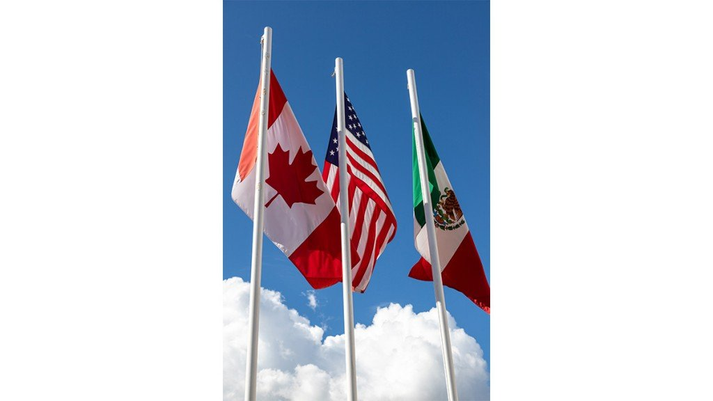 Flags Of United States, Mexico, Canada Fluttering In The Sky