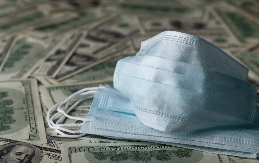 Edical Face Mask And Dollar Banknotes, World Coronavirus Epidemic And Economic Losses Concept.