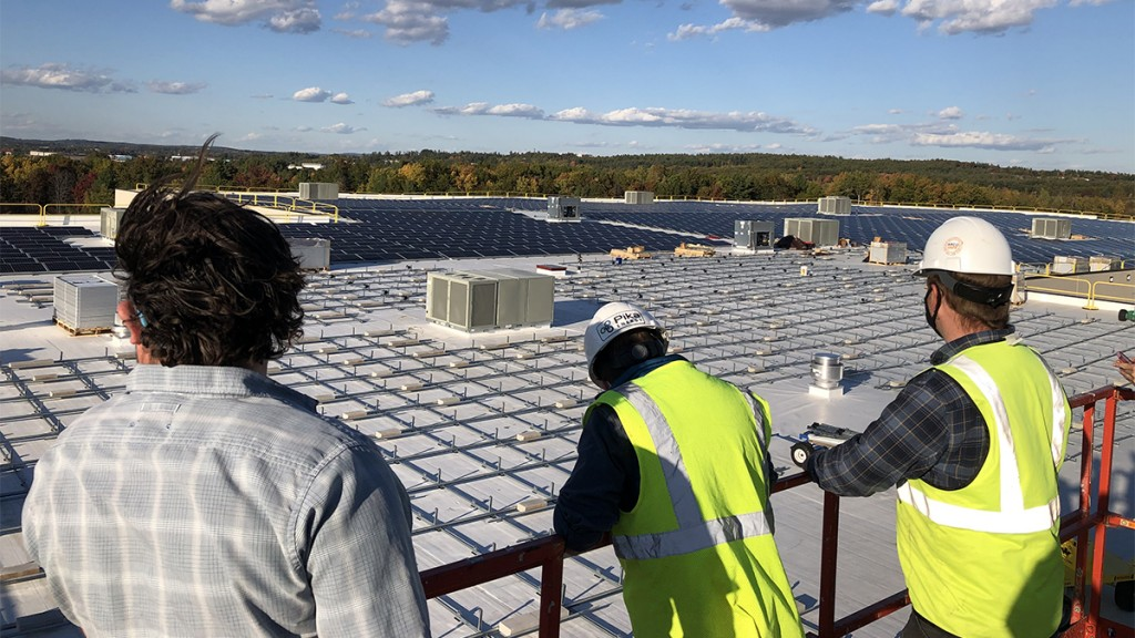 Bellavance Beverage Workers Look Out Over Solar Array1200