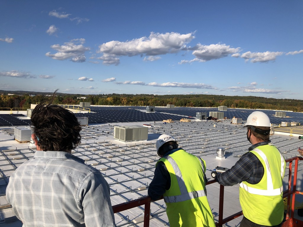 Bellavance Beverage Workers Look Out Over Solar Array