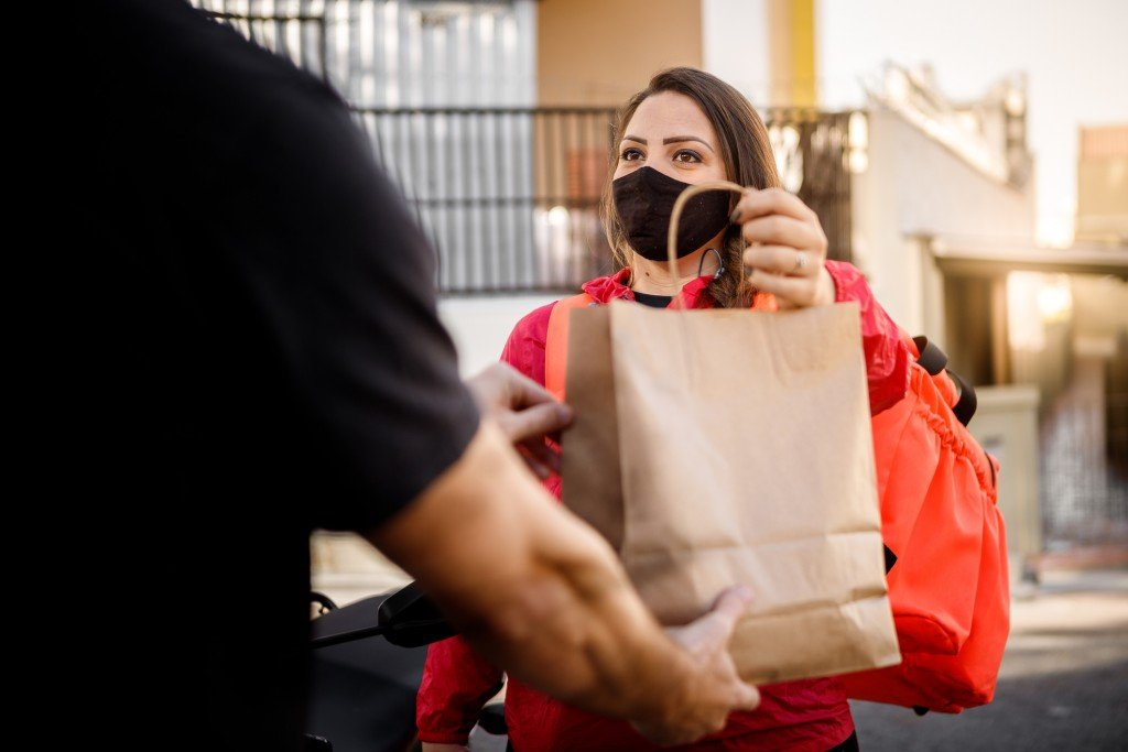 Woman With Mask Delivering Fastfood Motogirl