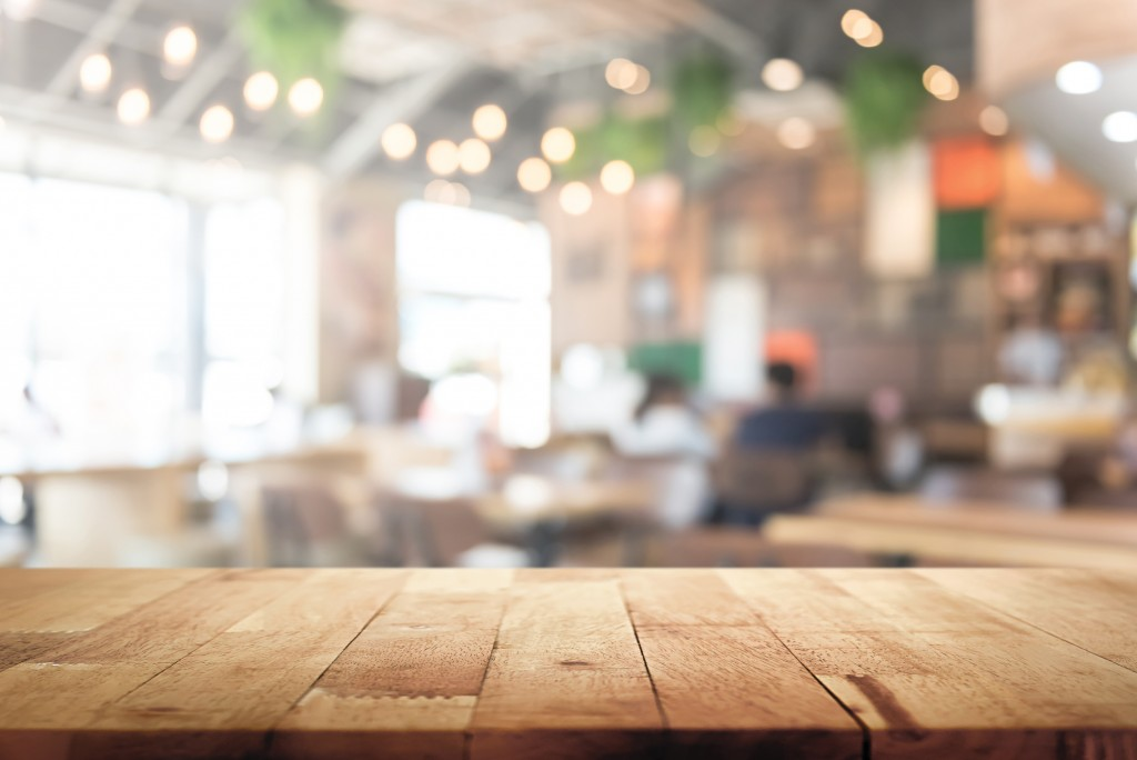 Wood Table Top On Blur Restaurant Interior Background