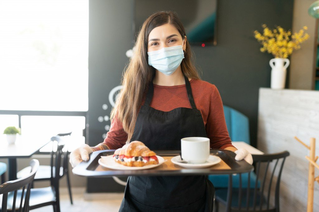 Female Server With Order In Tray At Cafe