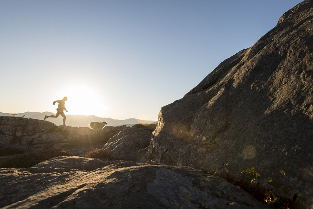 Trail Runner And His Dog At Sunset High Above North Conway, New Hampshire On South Moat Mountain.