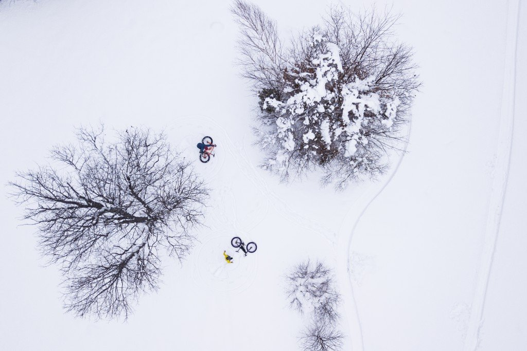 Mountain Bikers Taking A Break During A Winter Ride In Gorham, Nh
