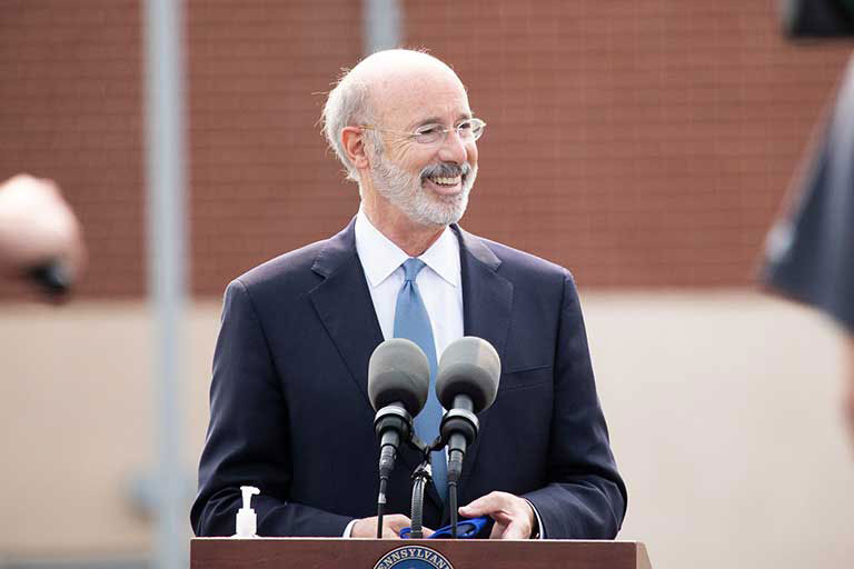 Governor Tom Wolf Smiling And Looking To His Left Outside