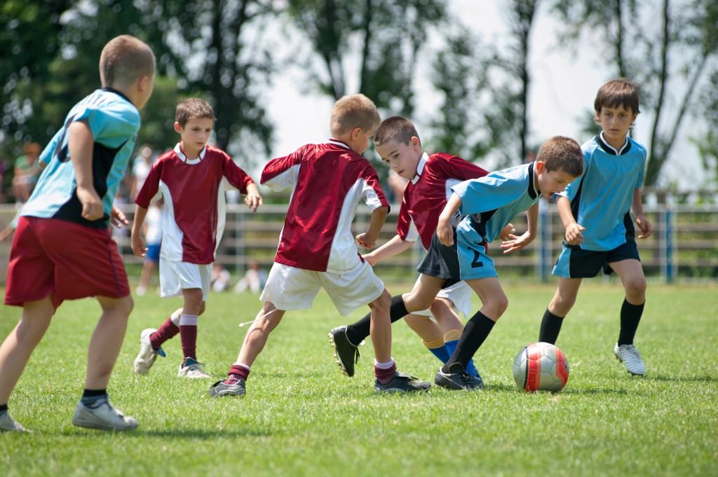 Kids Playing Football Outside
