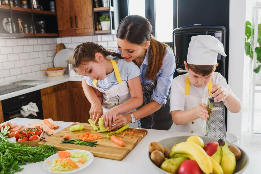 Mother Teaching Kids To Cook And Help In The Kitchen. Healthy Food. Eat Healthier.