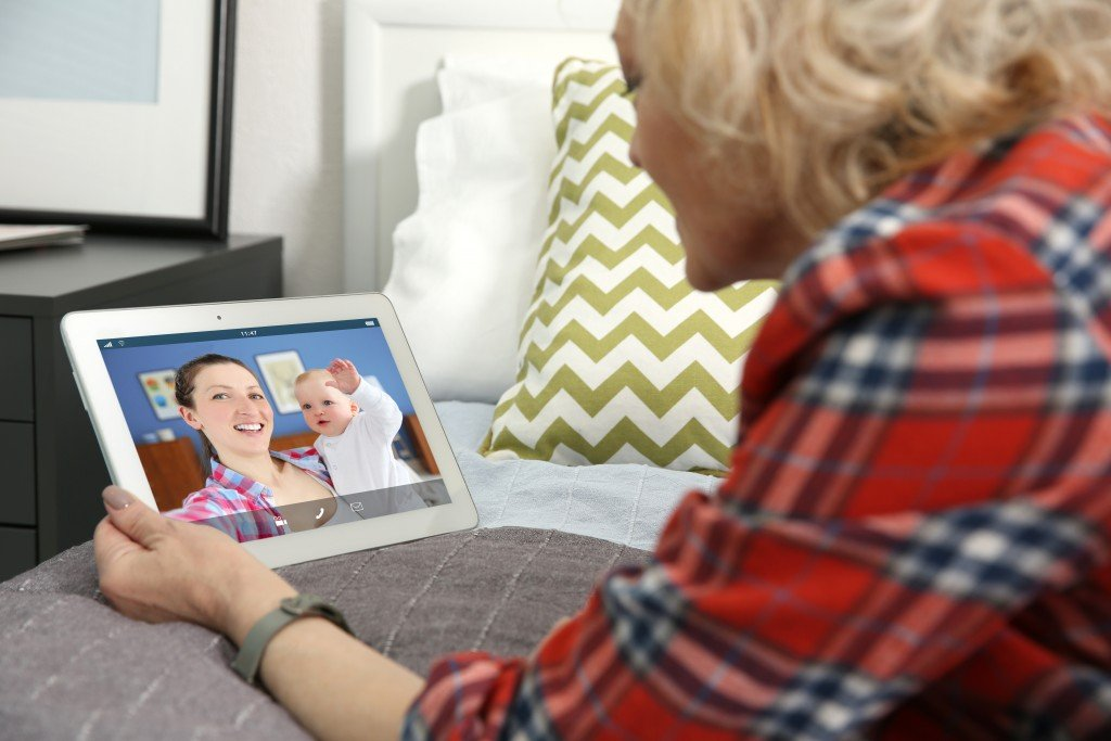 Video Call And Chat Concept. Senior Woman Video Conferencing On Tablet