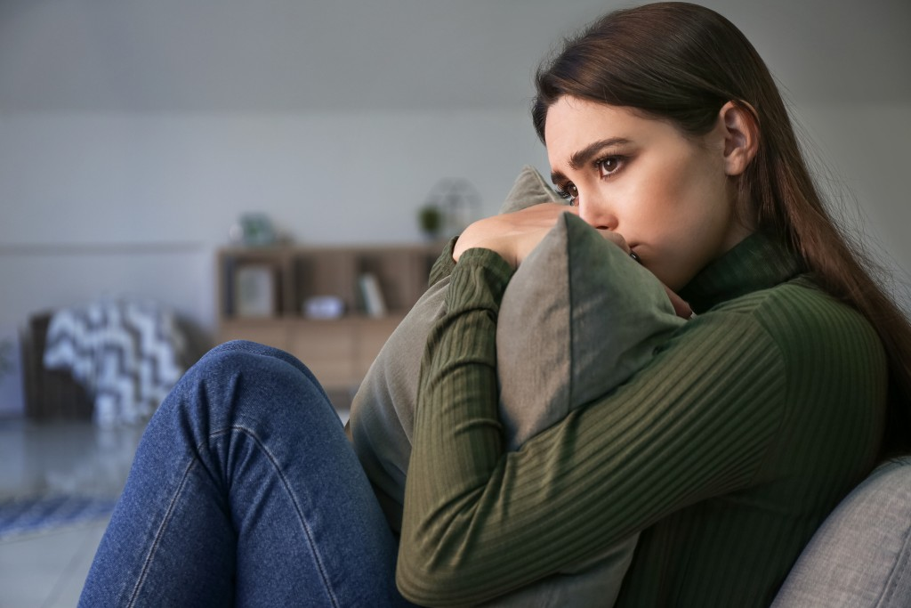 Depressed Young Woman At Home