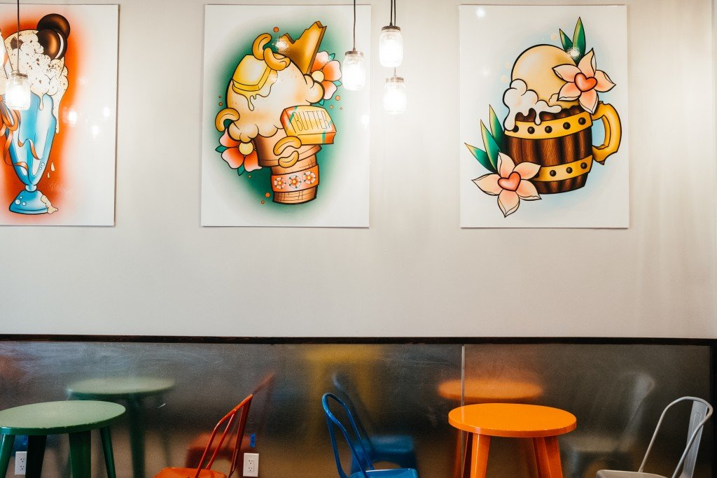 Depicts Devil May Car's interior seating and tattoo-style pictures of ice cream