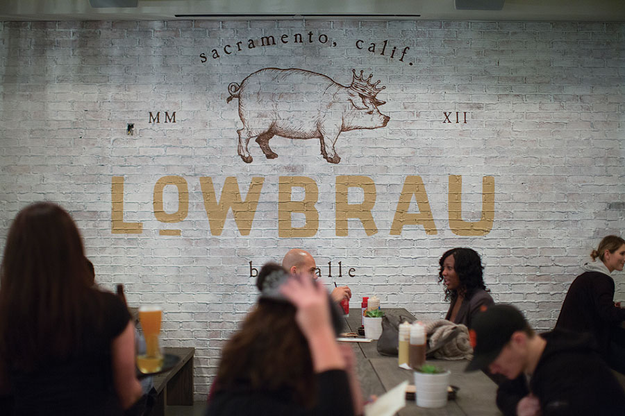 LowBrau seating consists exclusively of communal tables (which are made of reclaimed oak) to invite conversation among guests.
