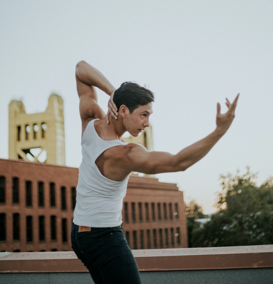 Anthony Cannarella strikes a pose on the rooftop of Project Church in Old Sacramento (Photo by Frances Chae)