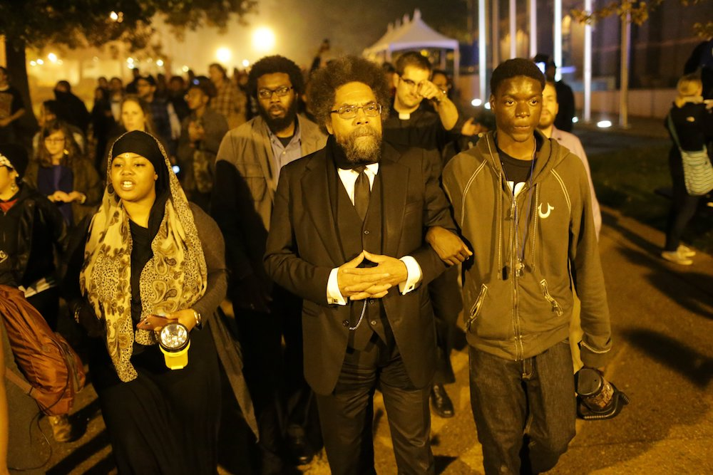 West marches in Ferguson, Missouri, on Oct. 13, 2014, to protest the fatal shooting of Michael Brown, an unarmed black teenager, by a white police officer. (Photo by David Carson/St. Louis Post-Dispatch/AP Photo)
