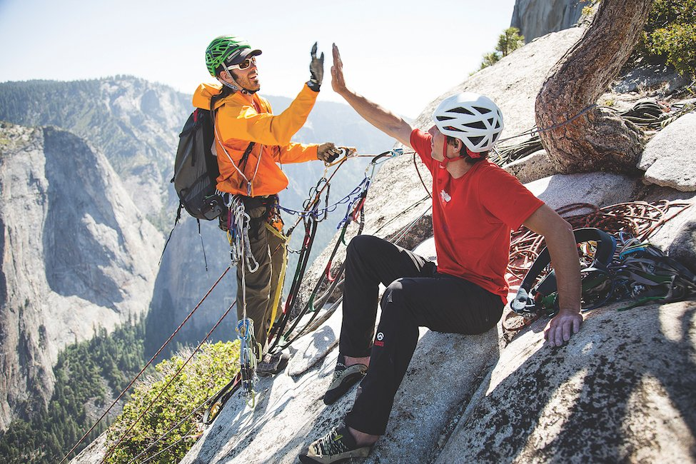 Honnold and climbing partner David Allfrey celebrate breaking the speed record on El Capitan's Tangerine Trip route. (Photo by Max Whittaker)