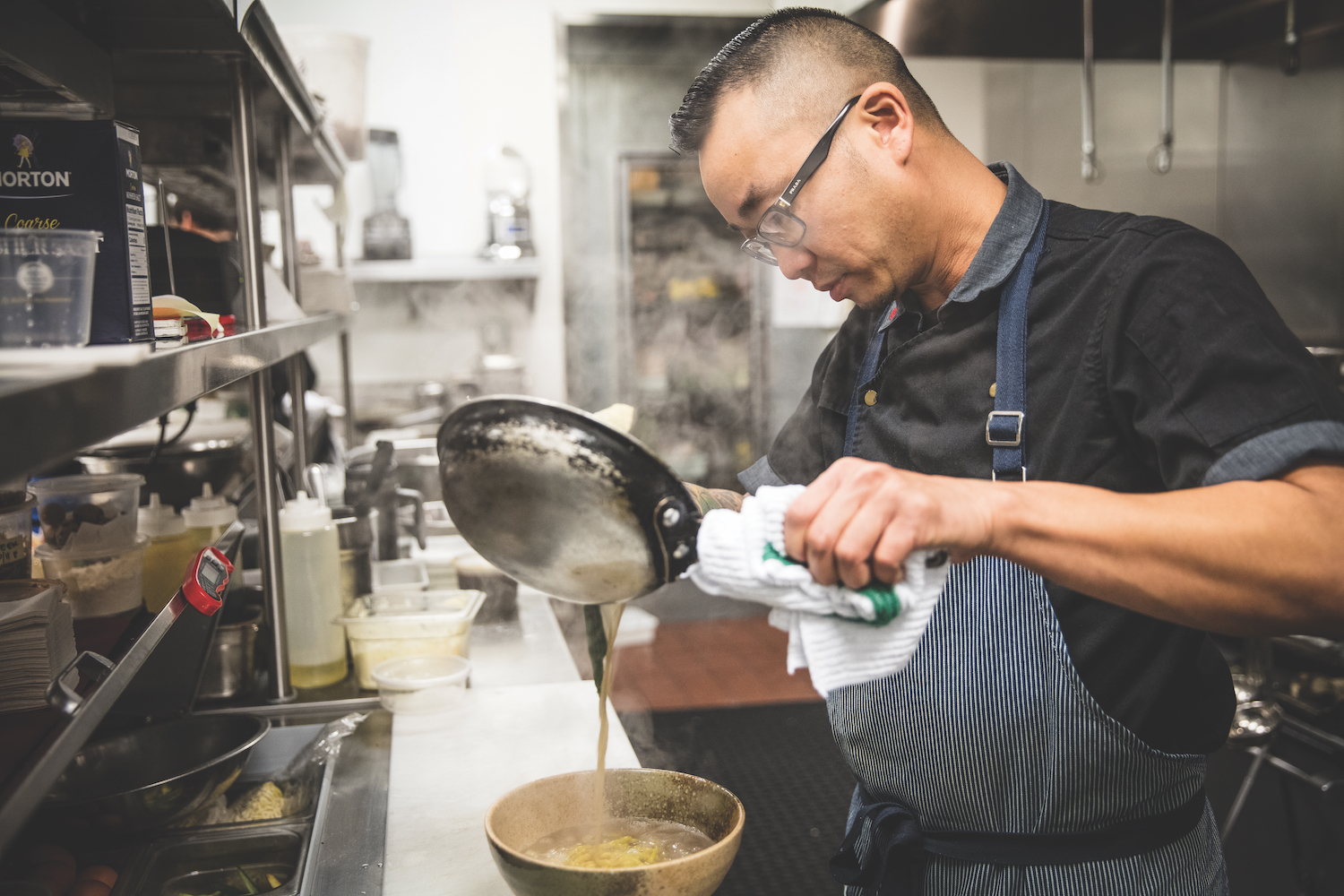 Ngo uses his noodles to create a ramen dish at Kru. (Photo by Max Whittaker)
