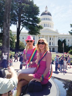 "Brandi Glanville (right) served as grand marshal of Sacramento Pride in June. Yolanda Foster, one of her co-stars on ""The Real Housewives of Beverly Hills,"" came along for the ride. (Photo by Fred Palmer/Outword Media Marketing & Events)"