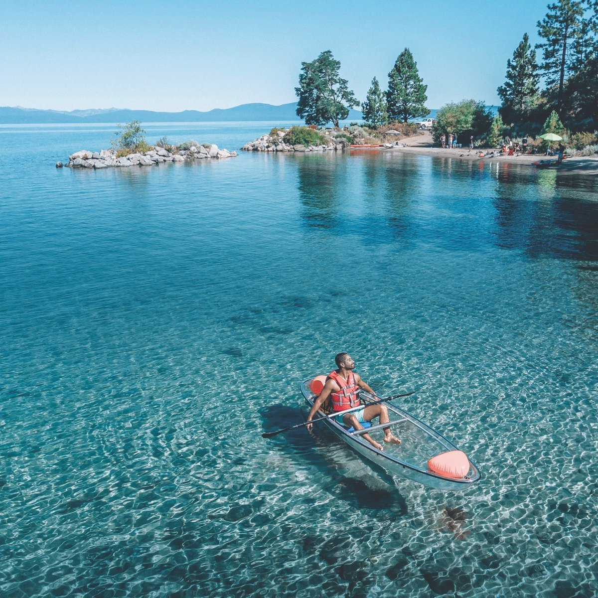 On a clear kayak, you can see forever—or at least 70 feet down into Lake Tahoe. (Photo by André De Mello)