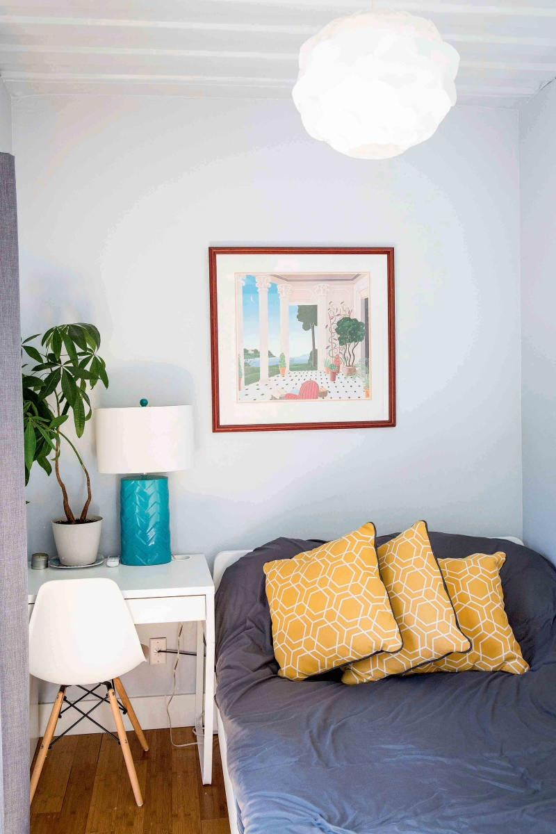 The bright, mod bedroom with pops of yellow and turquoise