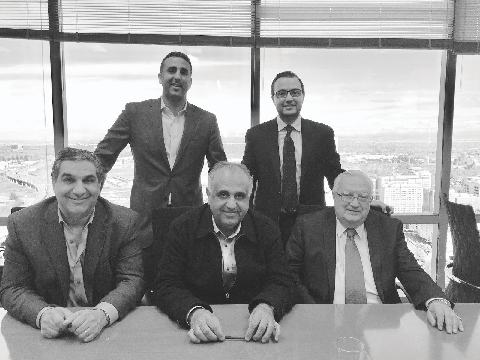 From left: Developers Steve Lebastchi, Bay Miry, David Miry, Ali Youssefi and Cyrus Youssefi in December 2014 after signing the closing documents for The Hardin. (Photo courtesy of Bay Miry)