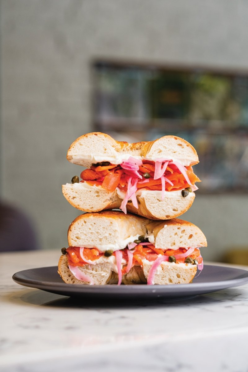The Russ bagel with house-cured lox, classic schmear, tomato, pickled onions and capers
