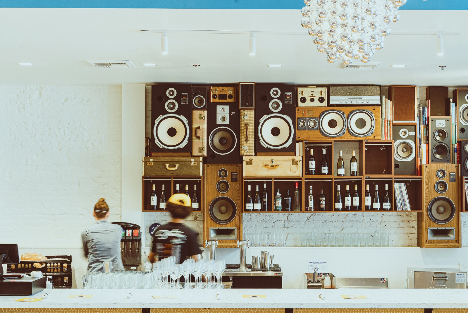 A display of vintage speakers serves as a nod to the downtown space's origins as a Tower Records store.