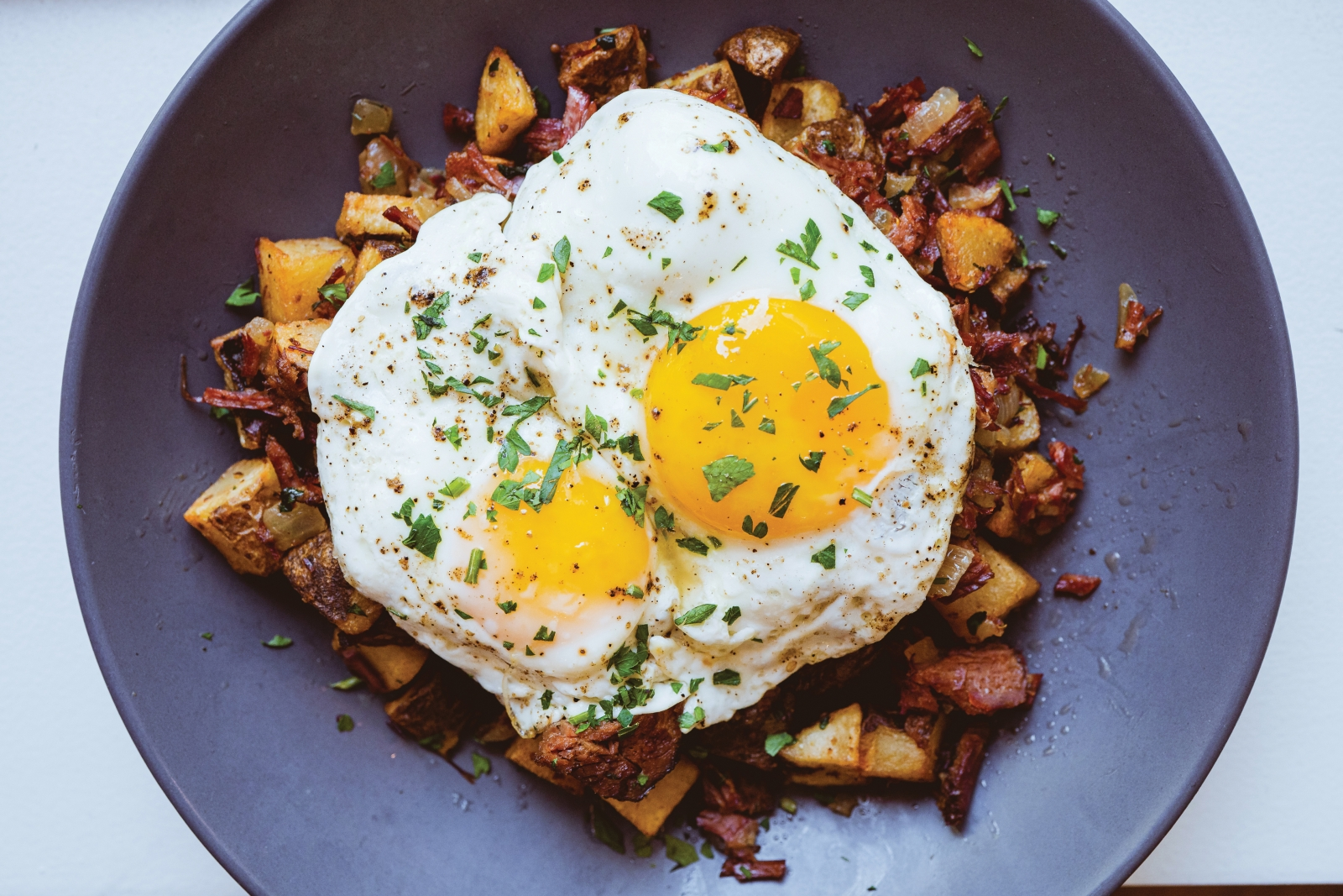 Like Solomon's other breakfast dishes, the pastrami and potato hash, topped with fried eggs, is served all day.