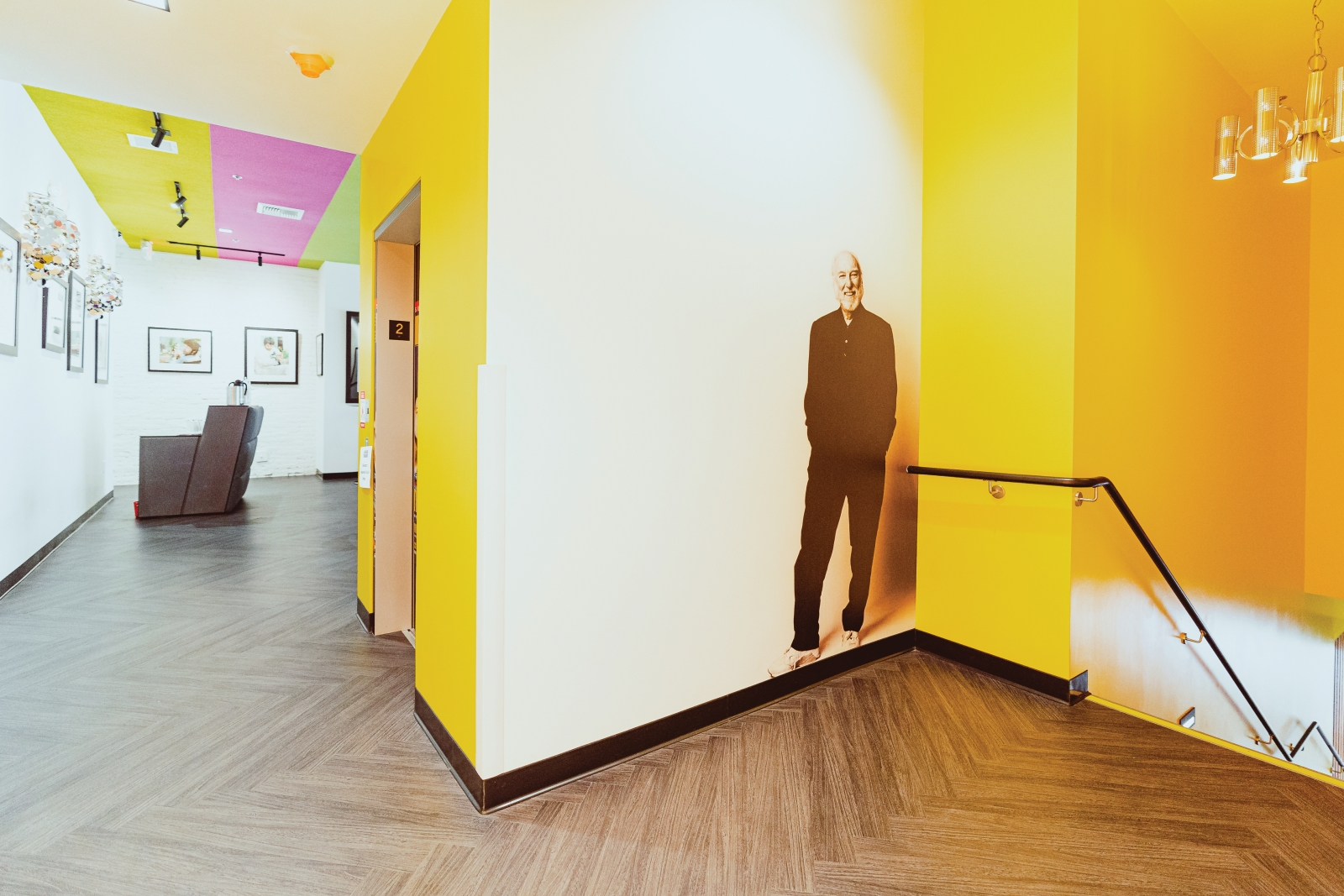 A life-size and selfie-ready likeness of Russ Solomon greets visitors to the second-floor Russ Room.