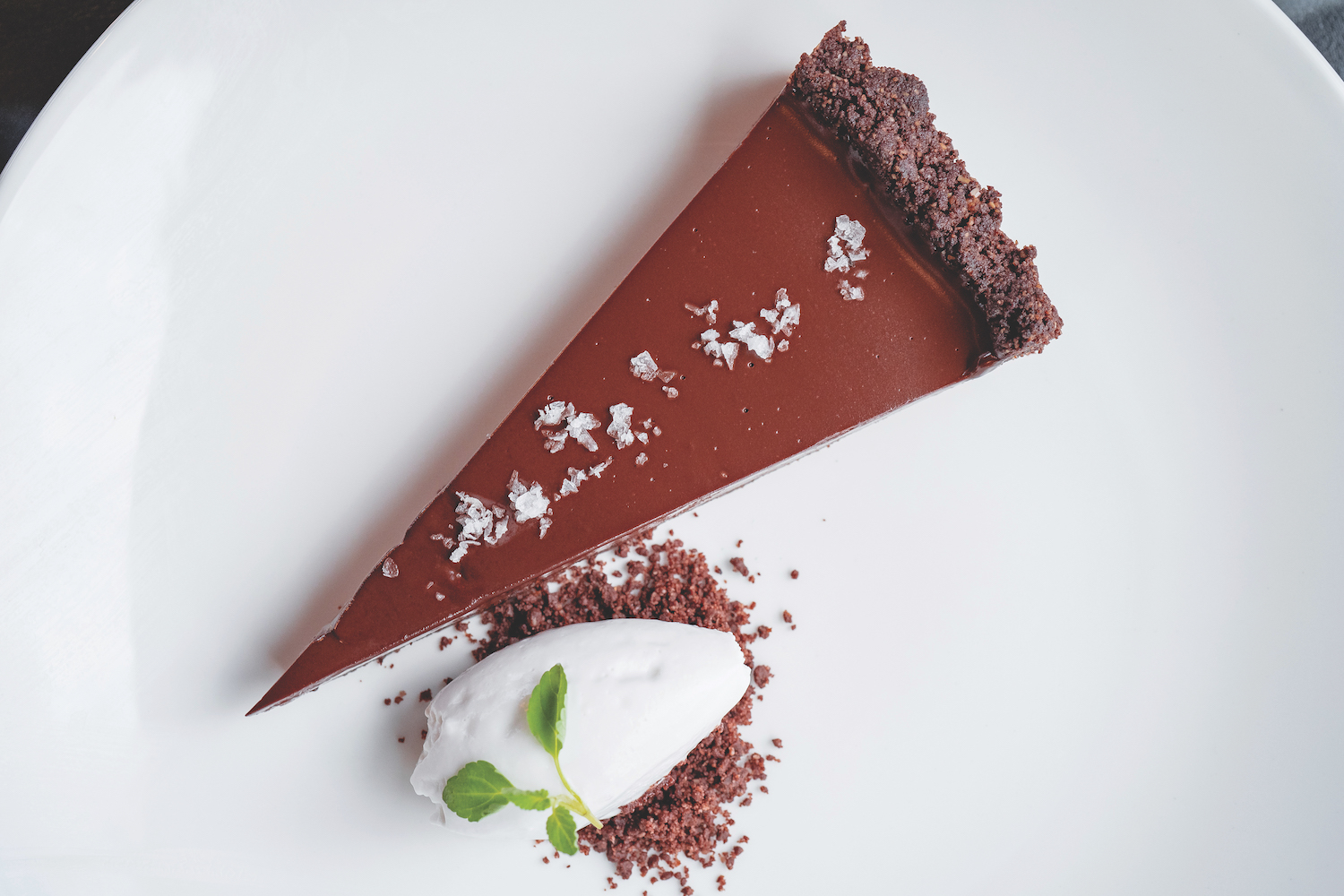 The vegan and gluten-free chocolate torte with house-made whipped cream