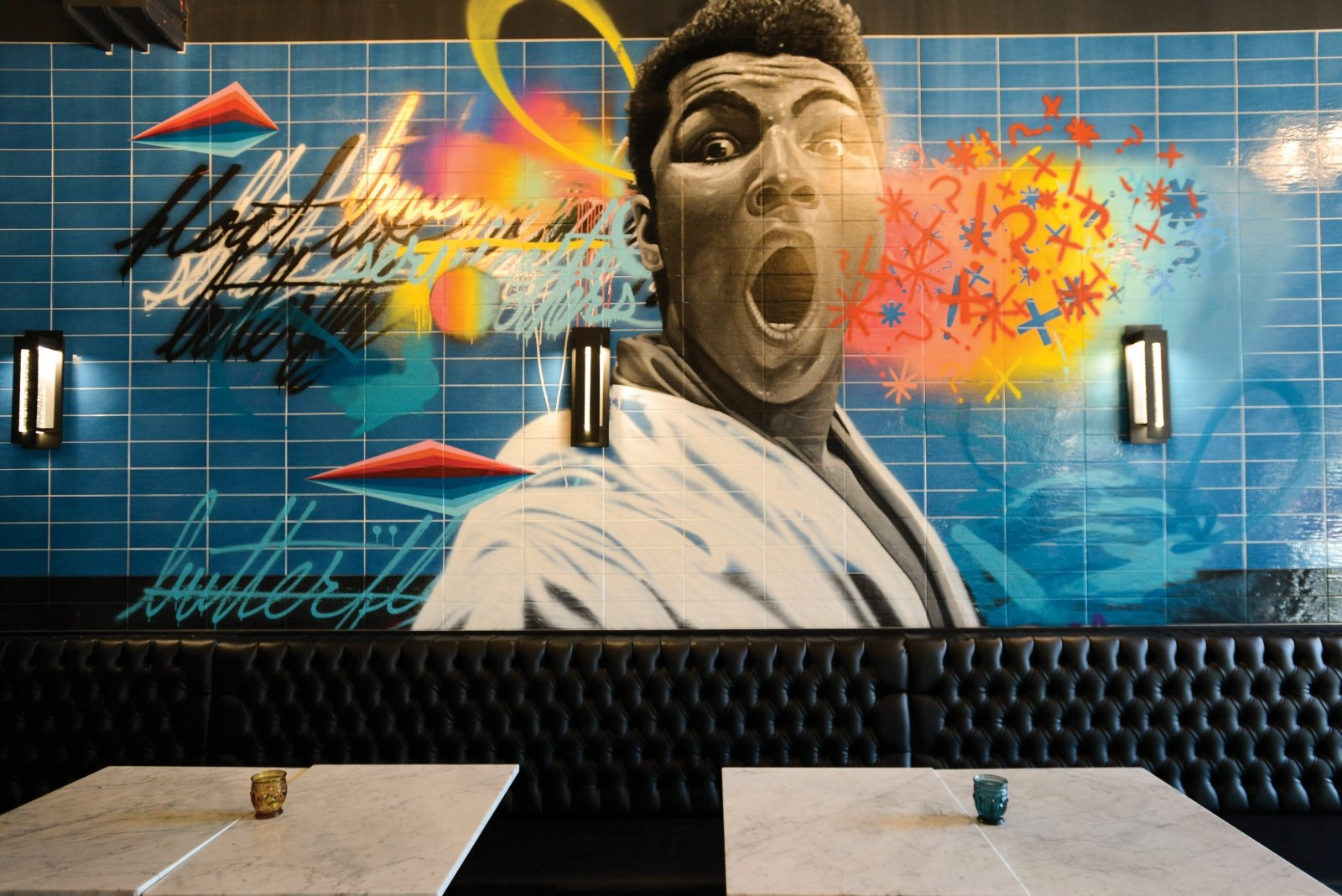 "A Muhammad Ali mural by Sacramento artist Jose Di Gregorio embodies the ""fiercely confident"" vibe of Bawk."