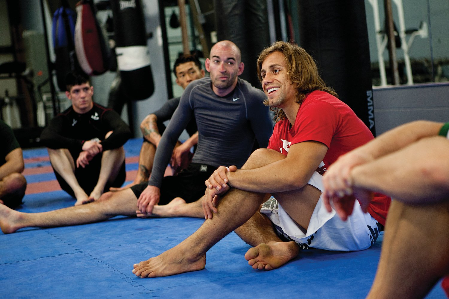 Faber talks to members of Team Alpha Male at his midtown gym. (Photo by Max Whittaker)
