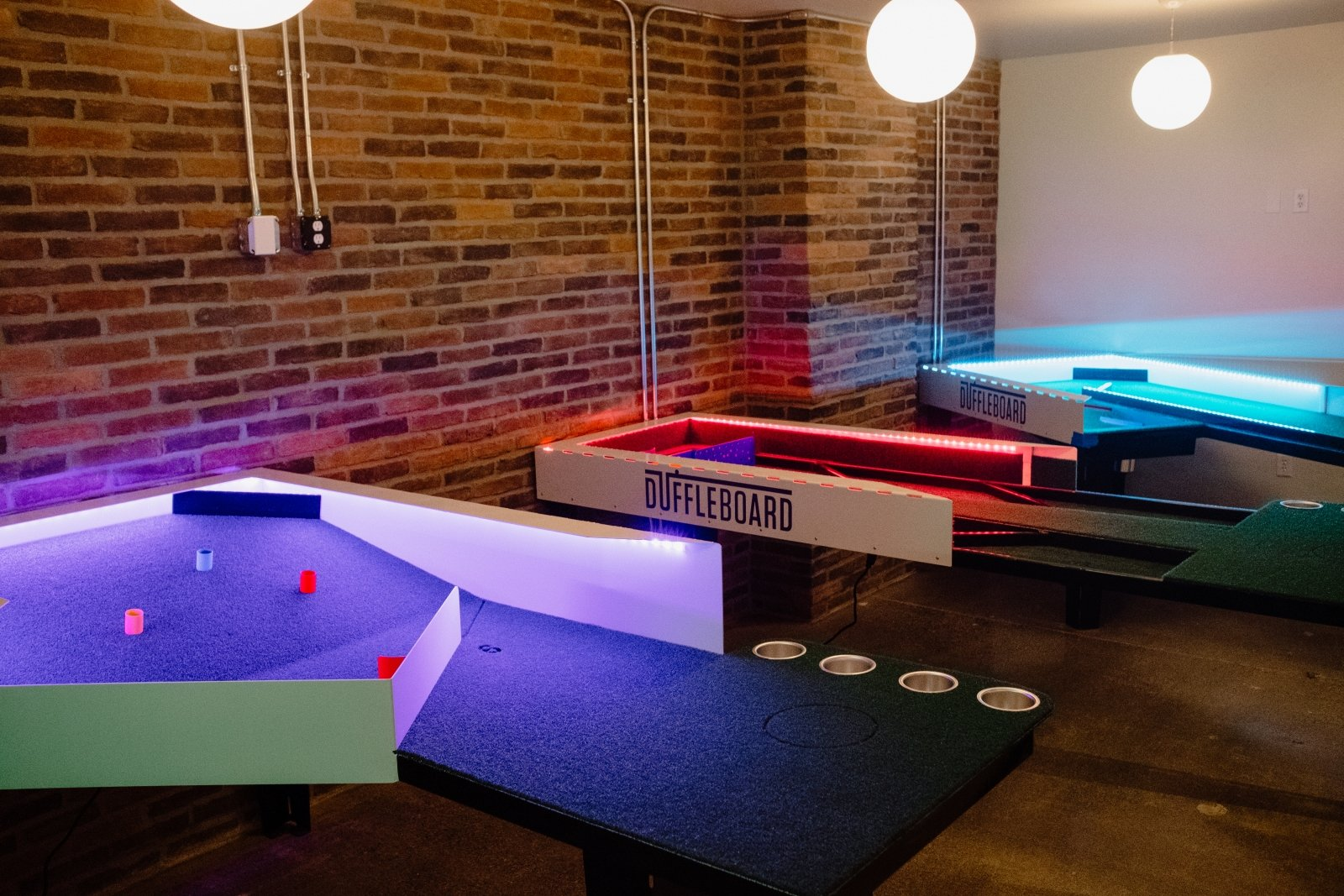 Duffleboard, a proprietary Flatstick Pub game that's part golf and part shuffleboard