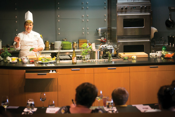 """Dinner theater"" takes on a new meaning as chef Hilary Sullivan Powers demonstrates how to prepare meals using farm-fresh ingredients at the CIA at Copia. (Photo by Jeremy Sykes)"
