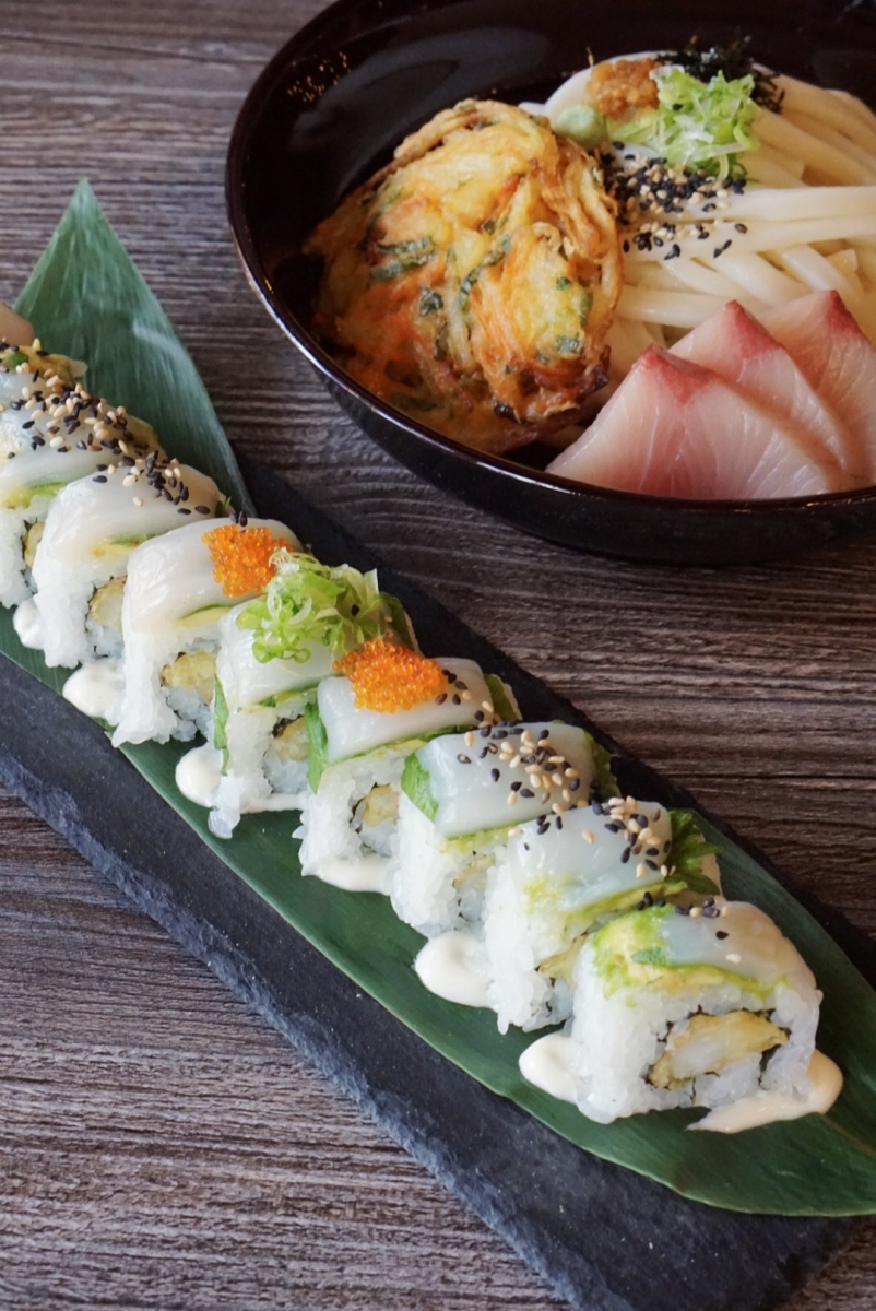 The Bistro Maki roll with tempura shrimp, crab, avocado, shiso, scallops and tobiko; and a bowl of cold udon with chilled broth, a veggie tempura patty and hamachi sashimi. (Photo courtesy of Aji Dori)