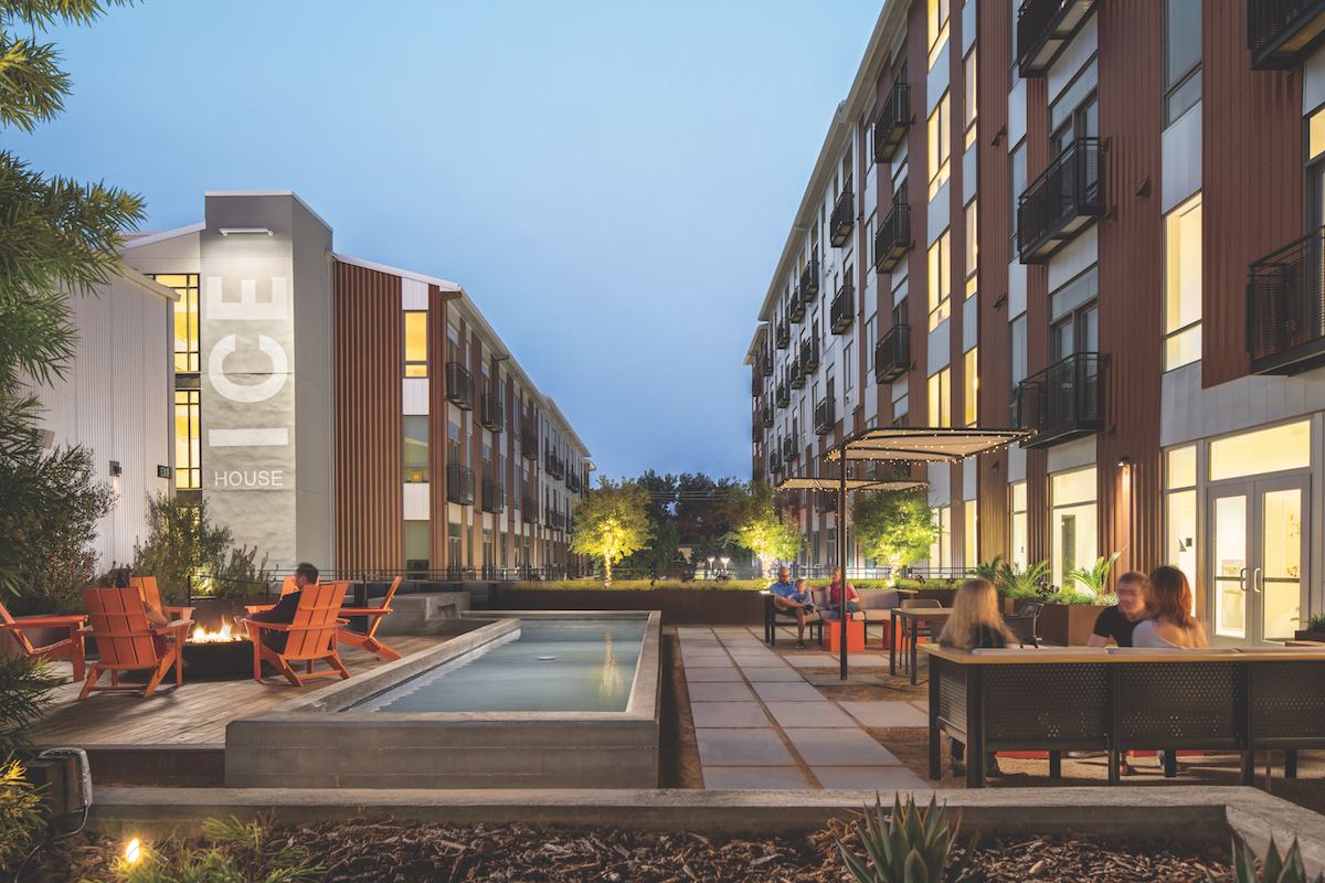 The second-story deck at Ice House, which is open to residents of the apartment complex, is made for lounging, with a reflecting pool, a fire pit and Adirondack chairs. (Photo by Chad Davies)