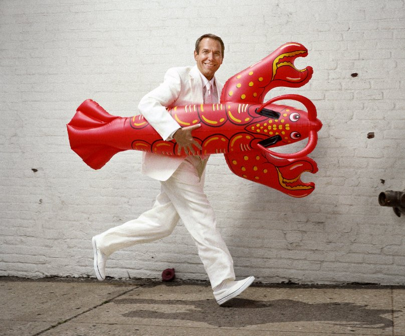 "Jeff Koons with a toy version of his ""Lobster"" sculpture (Portrait by Martin Schoeller/August)"