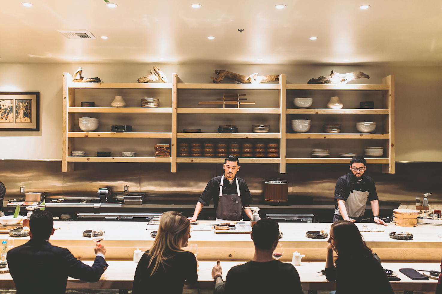 Kru boasts a 30-foot-long sushi bar and shelves displaying artisan ceramics and driftwood. (Photo by Black Field Media)
