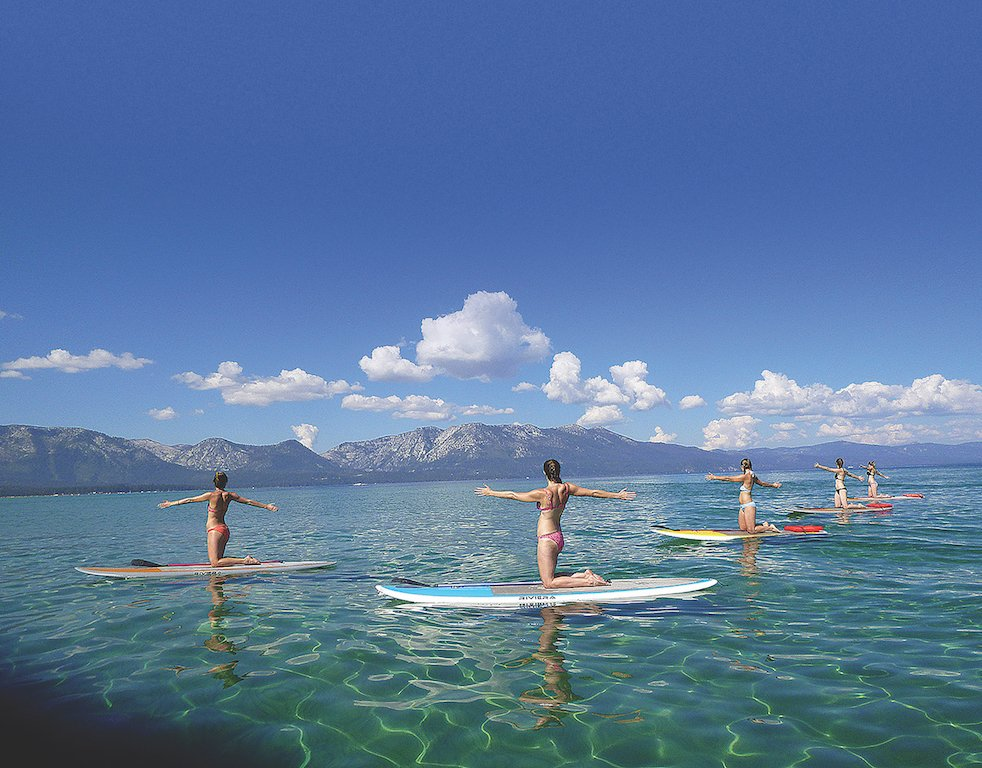 A call to arms: Stretch out during paddleboard yoga. (Photo courtesy of Lake Tahoe Yoga)