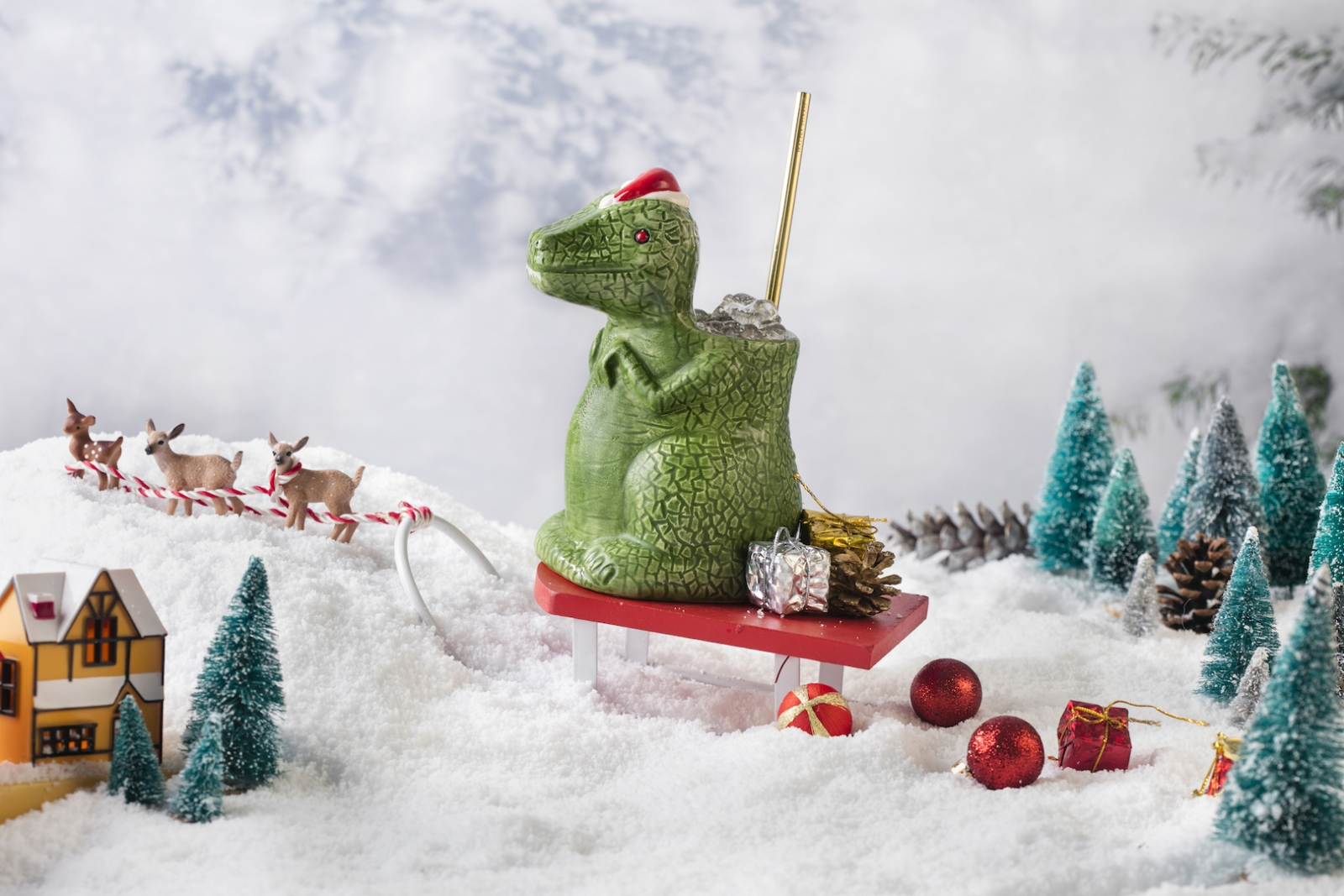 The new SanTaRex cocktail is served up in a mug shaped like the Cretaceous carnivore donning a Santa hat. (Photo by Melissa Horn, courtesy of Miracle)