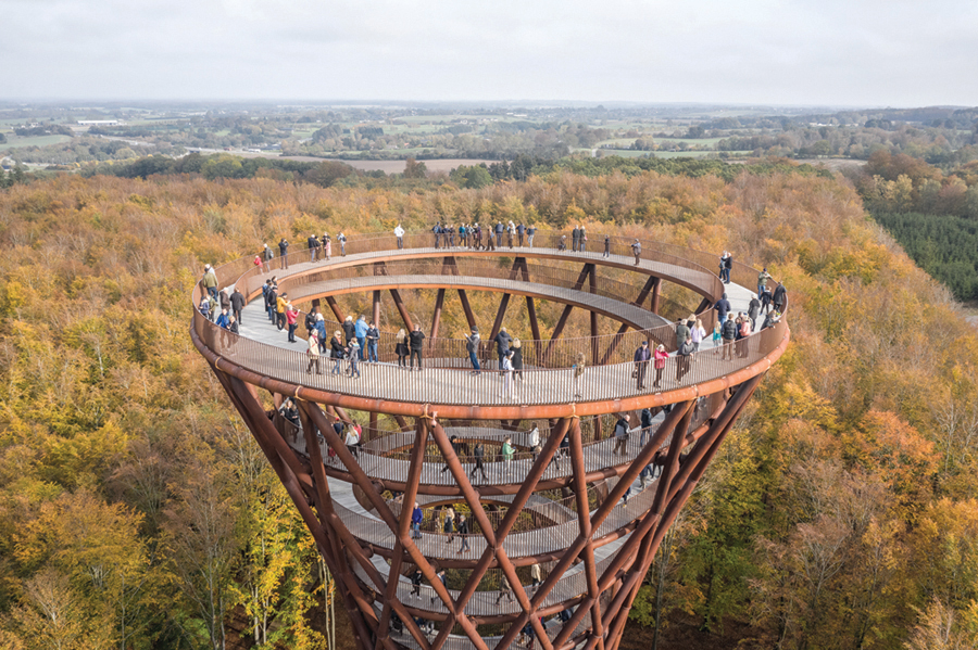 Do look down: The Forest Tower offers visitors breathtaking views of the lush tree canopy in Ronnede, Denmark. (Photos by Rasmus Hjortshoj, courtesy of Effekt and Camp Adventure)