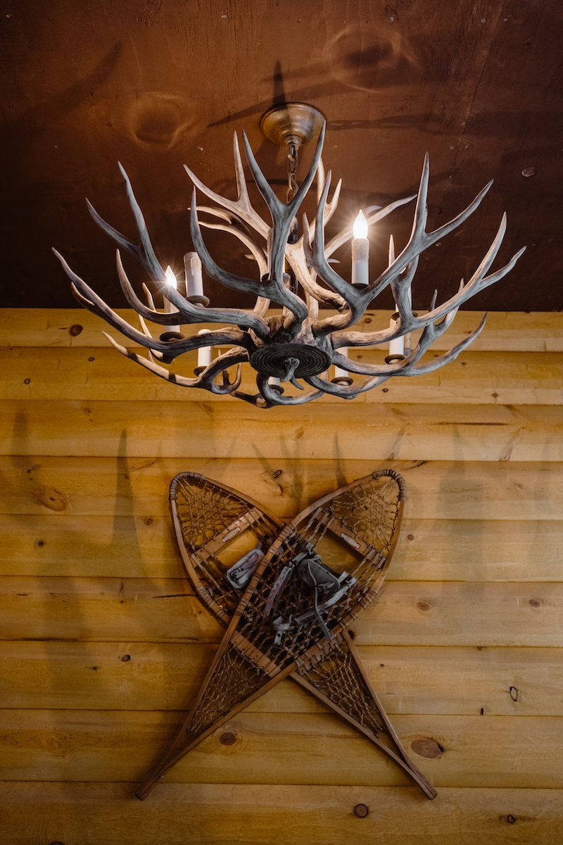 The Cabin will feature hand-built furniture and custom light fixtures, like this antler chandelier.