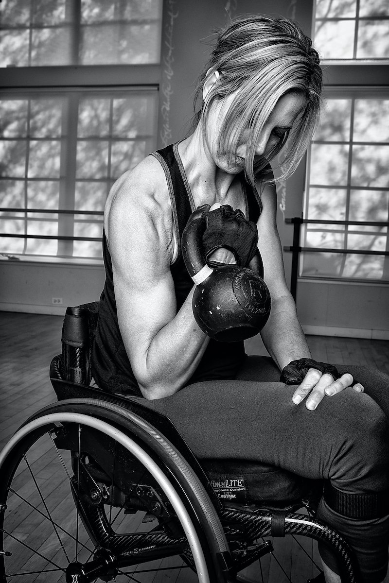 The elite CrossFit athlete uses kettlebells and other free weights to develop the upper body strength she needs for adapted exercises. (Photo by Doug Cupid)